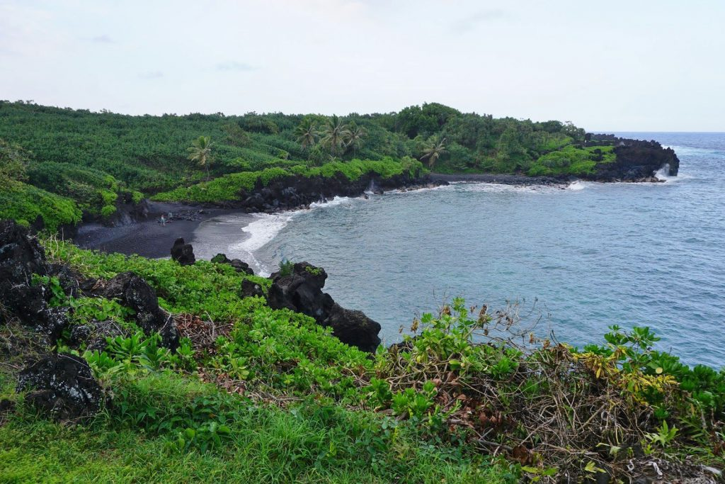 Honokalani Beach offers infamous black sands formed from the battering of lava flows and ocean waves for a thousand years.