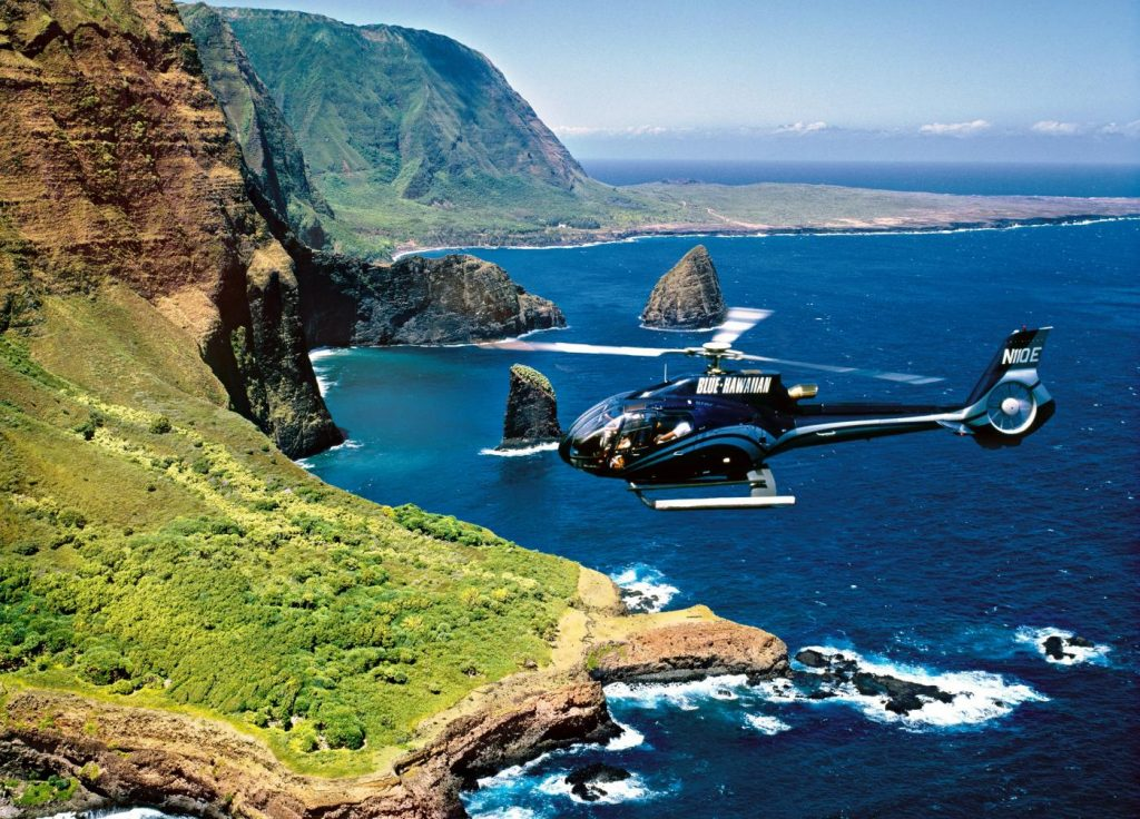 A Blue Hawaiian Helicopter touring the Maui coast.