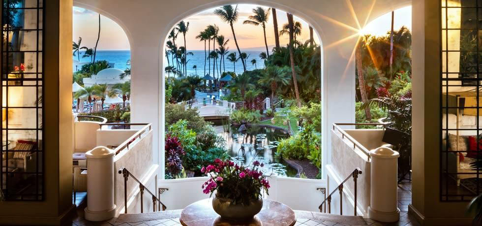 Fairmont Kea Lani presents Queen sofa beds, stone walk­-in showers, and private balconies with table and chairs.